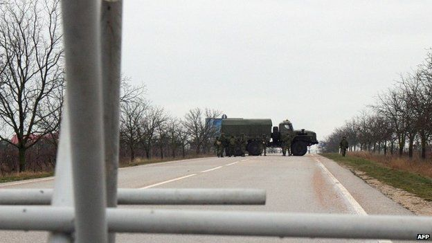 Men whom Ukraine says are Russian naval troops have also blocked roads to Sevastopol airport