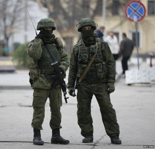 Unidentified soldiers are guarding key installations in Crimea