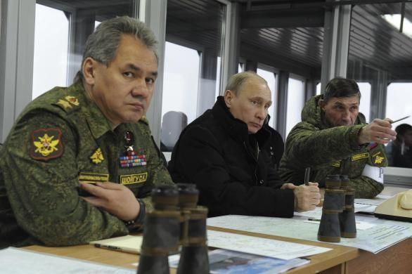 Russia's President Vladimir Putin (C), Defence Minister Sergei Shoigu (L) and head of the Russian army's main department of combat preparation Ivan Buvaltsev watch military exercises at the Kirillovsky firing ground in the Leningrad region, March 3, 2014.