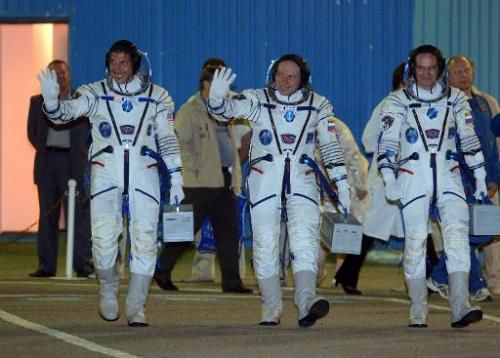 (L-R) US astronaut Michael Hopkins, Russian cosmonauts Oleg Kotov and Sergei Ryazansky at the Baikonur cosmodrome on September 25, 2013  Read more at: http://phys.org/news/2014-03-american-russians-earth-half-year-space.html#jCp