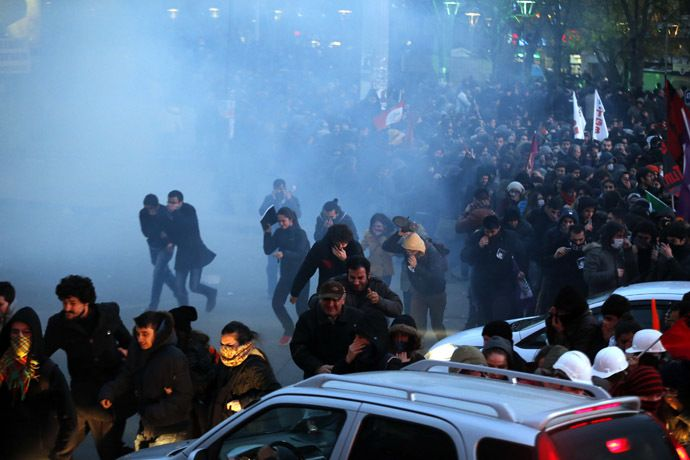 Anti-government protesters run as riot police fires tear gas during a demonstration in Ankara March 11, 2014. (Reuters)