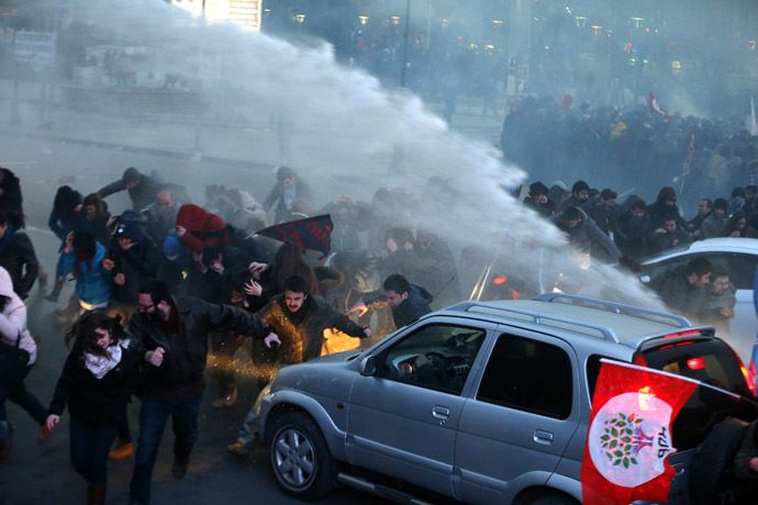 Protesters are hit by water cannon during clashes with riot police in Kadikoy, on the Anatolian side of Istanbul, on March 11, 2014. (AFP Photo)