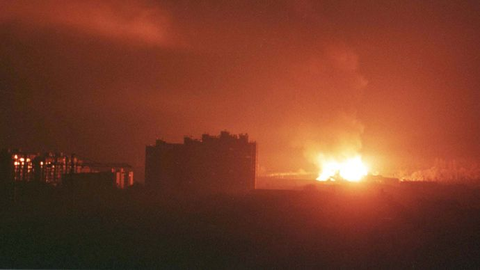 An explosion followed by a huge fire rages in the south-west part of Pristina in the early hours March 25, 1999 after NATO forces launched a missile attack against Yugoslavia (Reuters