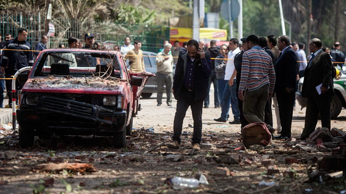 Egyptians inspect the damage after twin bombs struck police posts near Cairo University in the centre of Egypt's capital on April 2, 2014, which was followed by a third blast as police and journalists gathered at the scene. (AFP Photo