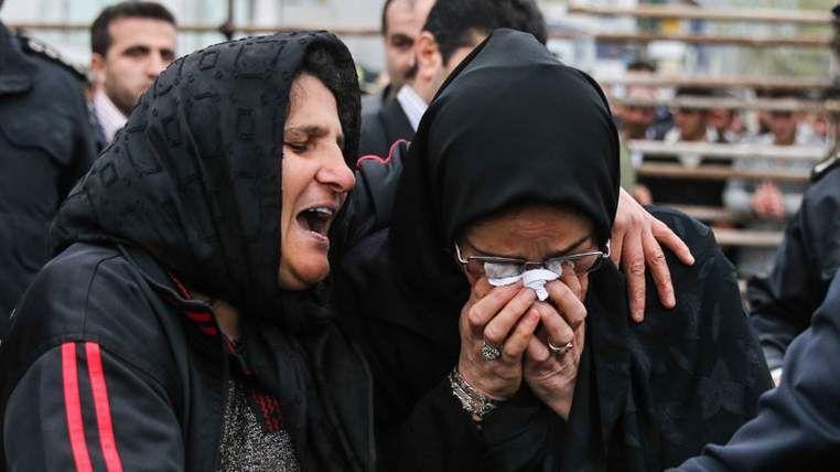 The killer's mother embraces Mrs Alinejad.