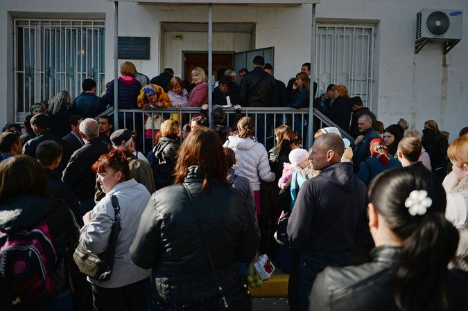 The line outside the government office in Simferopol, the capital of Crimea, where new Russian passports were being processed. Credit James Hill for The New York Times