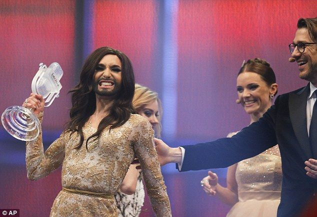 Ecstatic: The singer celebrates as she is awarded the winner's trophy for Eurovision 2014