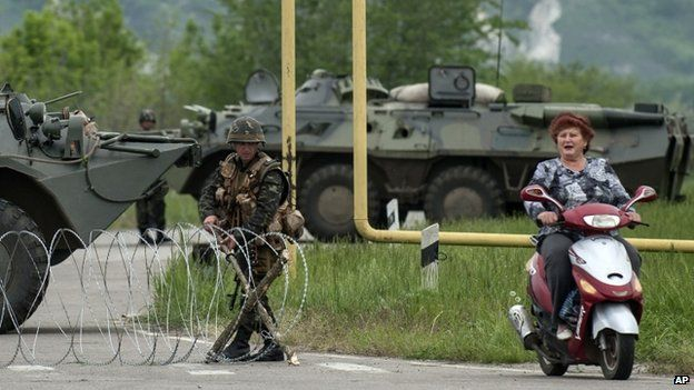 The Ukrainian army has set up checkpoints around Luhansk and other eastern cities. BBC