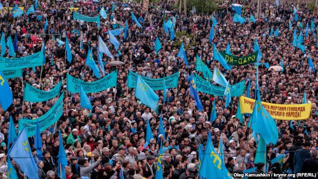 Crimean Tatars mourn those killed in the deportation at a rally on May 18 in Simferopol.