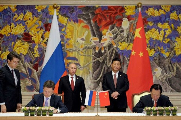 Xi (standing, right center) and Putin (left center) at the signing ceremony in Shanghai with Gazprom's Miller (seated, left) and CNPC Chairman Zhou Jiping (seated, right)