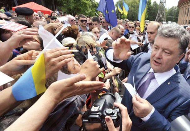 Ukrainian independent presidential candidate Petro Poroshenko, a billionaire member of parliament who has been a foreign and economic minister, is greeted by supporters during a campaign rally on May 17 in the industrial city of Kryvyi Rih in Dnipropetrovsk Oblast.