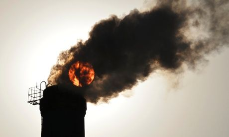 he sun is seen behind smoke billowing from a chimney of a heating plant in Taiyuan, Shanxi province (Photo:Reuters)