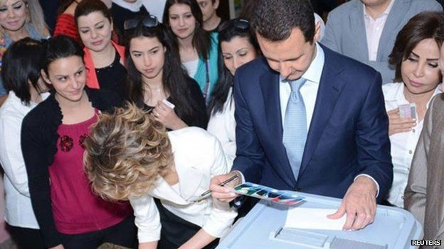 Syria's President Bashar al-Assad and his wife Asma cast their votes, 3 June President Assad himself voted in Damascus