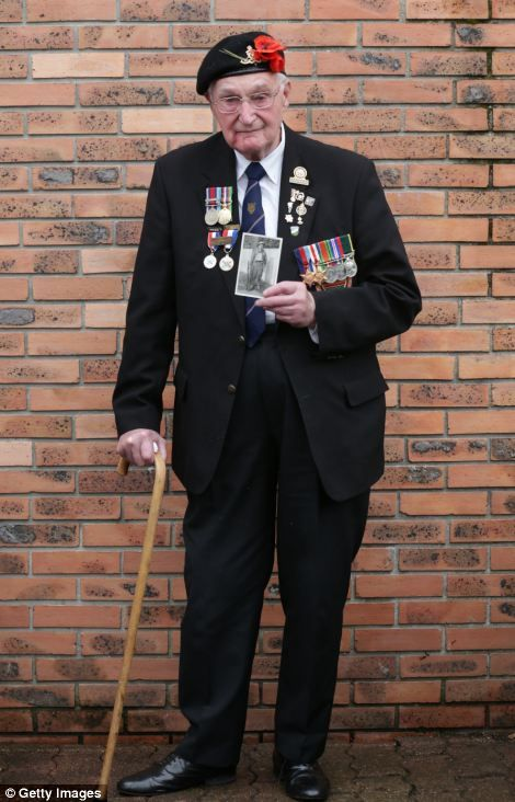 John Ainsworth, 93, who was in the Royal Artillery, brought a photograph of himself taken in 1940.