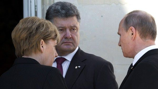 Mrs Merkel, Mr Poroshenko and Mr Putin are said to have chatted for a while.