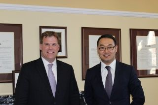 Deputy Minister of Foreign Affairs of Kazakhstan Yerzhan Ashikbayev and Canada's Minister of Foreign Affairs John Baird