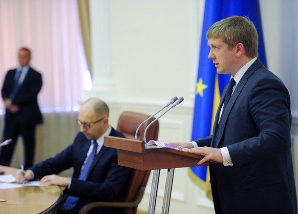 This handout photo taken and released on June 16, 2014 by the Prime Minister press-service shows Head of the Ukrainian Naftogaz state oil and gas firm Andriy Kobolev (R) speaking next to Ukrainian Prime Minister Arseniy Yatsenyuk (L) during a special hearing of the Cabinet ministers in Kiev. Ukraine said on June 16 that Russia had reduced its gas shipments and was only sending its neighbour enough to cover Europe's fuel needs after the two sides failed to reach a compromise price deal.