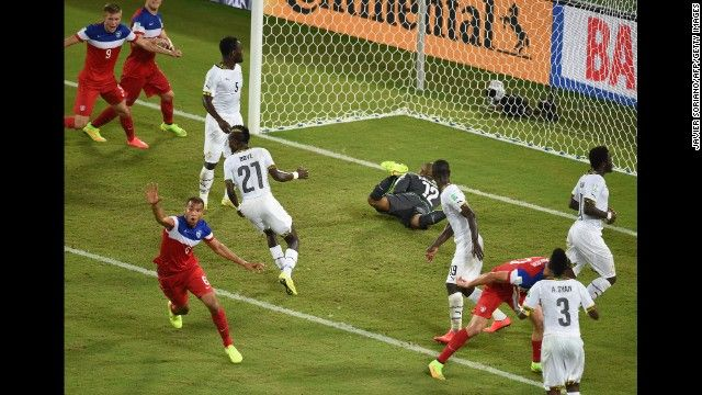 American defender John Brooks, bottom left, celebrates after scoring the winning goal against Ghana during a World Cup match Monday, June 16, in Natal, Brazil.