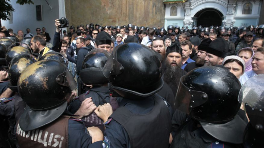 June 22, 2014: Riot police surround the Kiev Pechersk Lavra, an Orthodox Christian monastery, where radical masked activists gather to protest against separatists, who congregate in the area around the Kiev Pechersk Lavra.AP