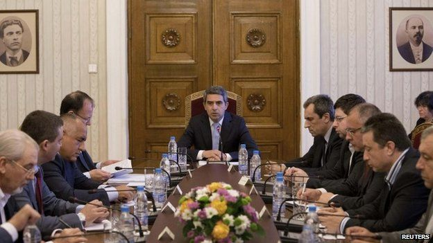 President Plevneliev (centre) said he would name a caretaker cabinet in August