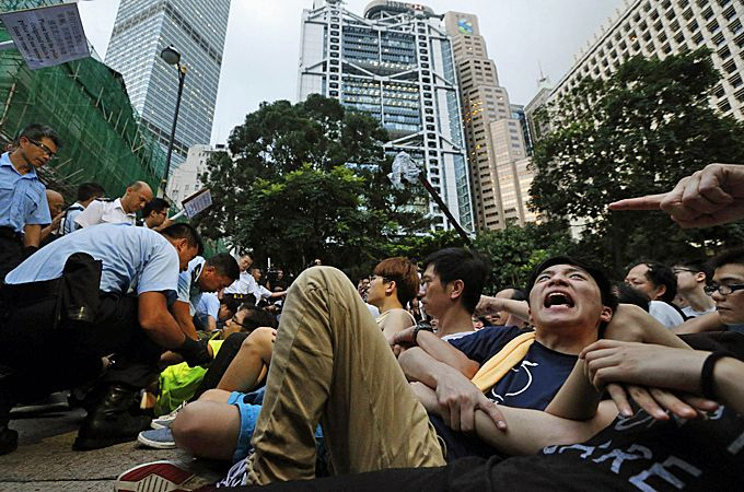 Some protesters resisted and stayed on, but many were physically removed [Reuters]