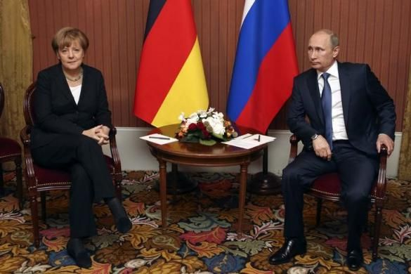 Russian President Vladimir Putin meets with German Chancellor Angela Merkel in Deauville, Northern France June 6, 2014.