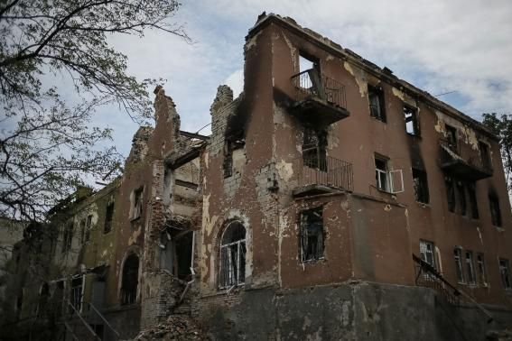 Buildings damaged by a recent shelling are seen in the eastern Ukrainian village of Semenovka July 9, 2014.