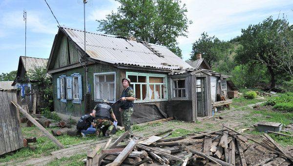 A house in Donetsk, a town in southern Russia's Rostov Region, hit by a shell fired from the Ukrainian side of the border