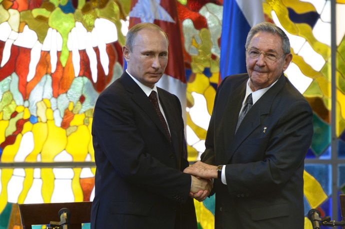 Russian President Vladimir Putin, left, and President of the Council of State and Ministers of the Republic of Cuba Raul Castro Ruz during a press statement at the Palace of the Revolution in Havana. (RIA Novosti)