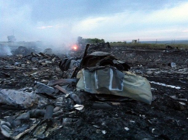 A picture taken on July 17, 2014 shows wreckages of the malaysian airliner carrying 295 people from Amsterdam to Kuala Lumpur after it crashed, near the town of Shaktarsk, in rebel-held east Ukraine. Pro-Russian rebels fighting central Kiev authorities claimed on Thursday that the Malaysian airline that crashed in Ukraine had been shot down by a Ukrainian jet. AFP photo.
