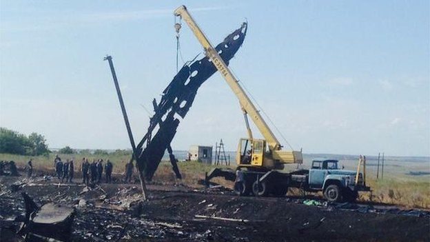 A crane at the crash site lifting large pieces of debris, 20 July 2014  A crane could be seen at the crash site lifting large pieces of wreckage