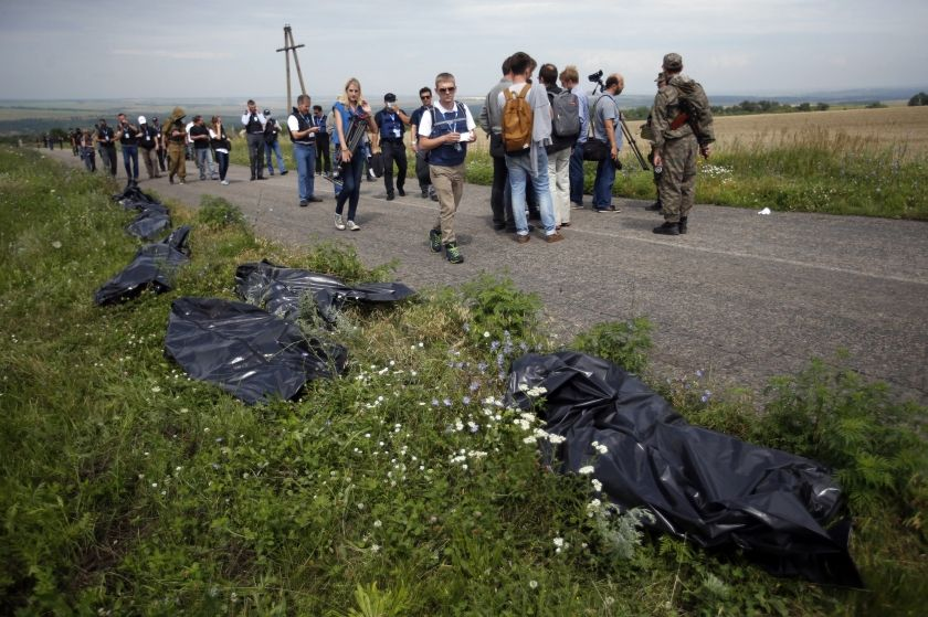 Organisation for Security and Cooperation in Europe (OSCE) monitors walk at the crash site of Malaysia Airlines Flight MH17, near the settlement of Grabovo in the Donetsk region July 20, 2014. ― Reuters pic - See more at: http://www.themalaymailonline.com/malaysia/article/observers-got-under-3-hours-at-mh17-crash-site-us-claims#sthash.KkRiQIo6.dpuf