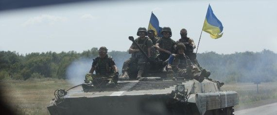 Ukrainian troops move near the village of Debaltseve, Donetsk region, eastern Ukraine, Thursday, July 31, 2014. (AP Photo)