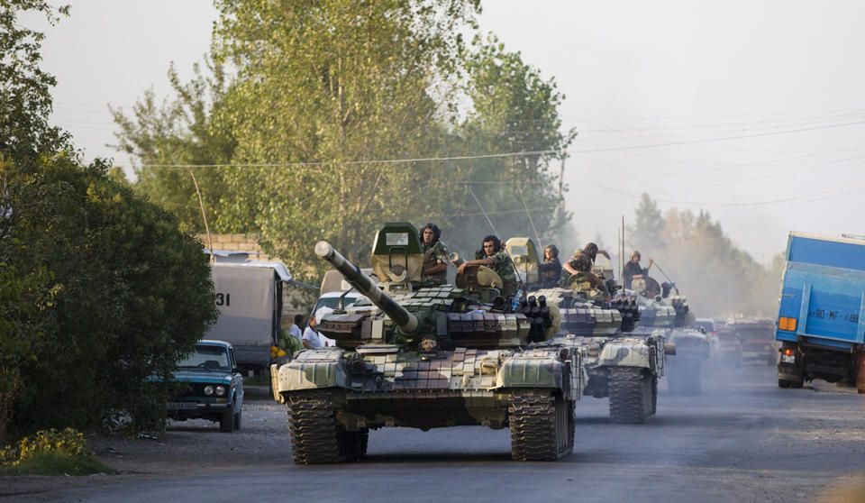 In this Saturday, Aug. 2, 2014, photo a convoy of Azerbaijan's Army tanks moves in the direction of Agdam, Azerbaijan. Recent days have seen a sharp escalation in fighting between Azerbaijan and Armenia around a tense line of control around Nagorno-Karabakh. (AP)