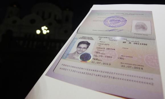 File photo of fugitive former US spy agency contractor Edward Snowden's new refugee documents granted by Russia displayed during a news conference in Moscow on August 1, 2013. (Reuters)