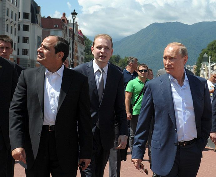 Russian President Vladimir Putin (R) and his Egyptian counterpart Abdel Fattah al-Sisi (L) walk on the main embankment in the Roza Khutor Village outside Sochi on August 12, 2014 during the Egyptian leader's first official visit to Russia. (AFP Photo)