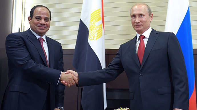 Russian President Vladimir Putin (R) shakes hands with his Egyptian counterpart Abdel Fattah al-Sisi (L) during their meeting at the Bocharov Ruchei residence in Sochi on August 12, 2014 during the Egyptian leader's first official visit to Russia. (AFP Photo
