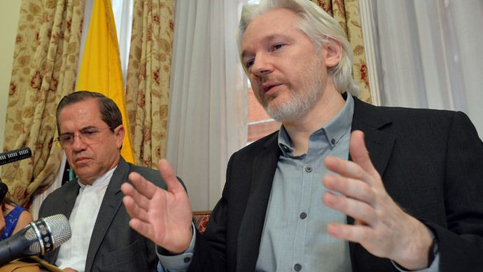 WikiLeaks founder Julian Assange (R) speaks as Ecuador's Foreign Affairs Minister Ricardo Patino listens, during a news conference at the Ecuadorian embassy in central London August 18, 2014. (Reuters