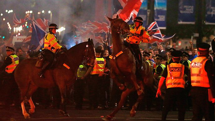 A police horse rears up as pro-union protestors clash with pro-independence protestors during a demonstration at George Square in Glasgow, Scotland September 19, 2014 (Reuters)