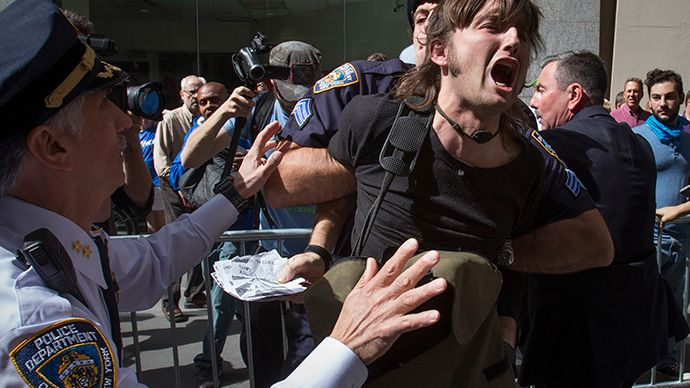 New York City police officers arrest a man taking part in the Flood Wall Street demonstration in Lower Manhattan, New York September 22, 2014. (Reuters / Adrees Latif)