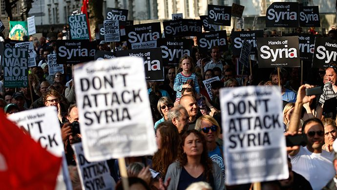 Protesters listen to speeches during a rally against the proposed attack on Syria in central London August 28, 2013 (Reuters)