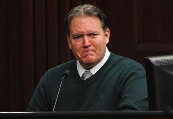 Defendant Michael Dunn reacts on the stand during testimony in his own defense during his murder trial in Duval County Courthouse in Jacksonville, Florida in this photo taken February 11, 2014.