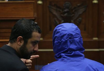 yrian Army defector Caesar, (in a blue hooded jacket) who has smuggled out of Syria more than 50,000 photographs …