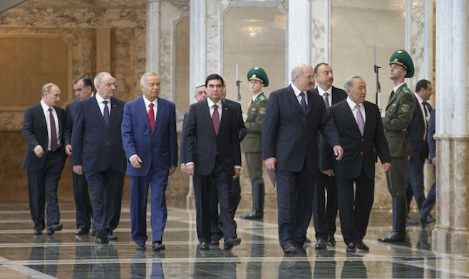 (L-R) Russia's President Vladimir Putin, Tajikistan's President Emomali Rahmon, Moldova's President Nicolae Timofti, Uzbekistan's President Islam Karimov, Armenia's President Serzh Sargsyan, Turkmenistan's President Gurbanguly Berdimuhamedov, Belarus' President Alexander Lukashenko, Azerbaijan's President Ilham Aliyev and Kazakhstan's President Nursultan Nazarbayev walk before posing for a family photo during a summit of the Commonwealth of Independent States (CIS) in Minsk, Belarus.