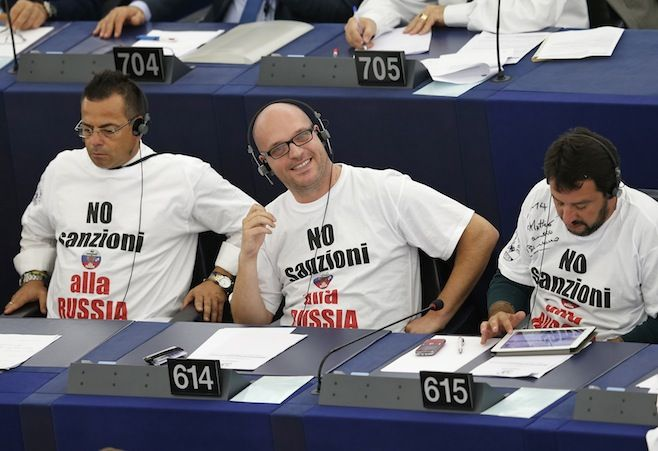Italian Members of the European Parliament Gianluca Buonanno (L), Lorenzo Fontana (C) and Matteo Salvini attend a voting session on the EU-Ukraine Association agreement at the European Parliament in Strasbourg, September 16, 2014. The slogan on the shirts reads,