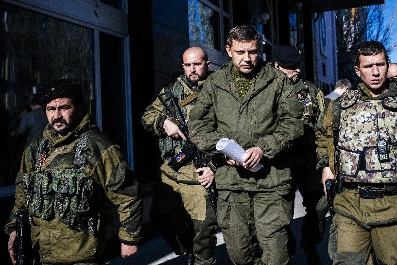 Pro-Russian rebel leader Alexander Zakharchenko, centre, surrounded by his security.