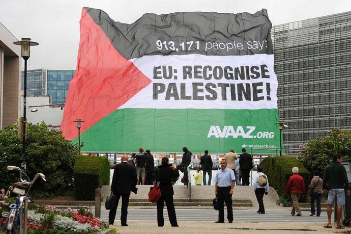 A Palestinian flag, bearing the slogan: