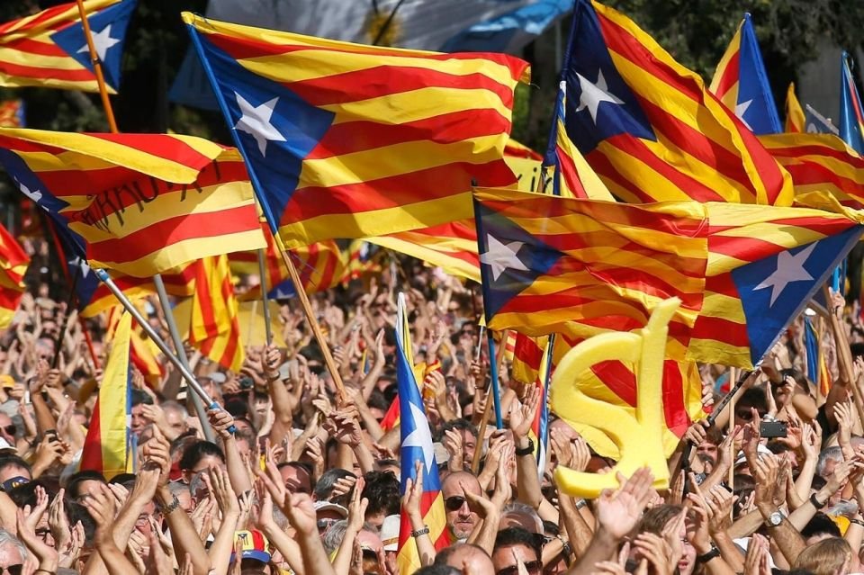At a pro-independence celebration in Barcelona, Spain, the crowd waves the Catalonian separatist flag, Oct. 19, 2014. On Nov. 9, 2014, Catalonians will vote in a nonbinding poll on the region's independence from Spain. Albert Gea / Reuters