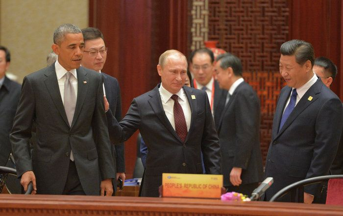 Russia's President Vladimir Putin, Chinese President Xi Jinping, his wife Peng Liyuan and U.S. President Barack Obama