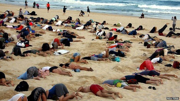 The protesters took to Sydney's Bondi Beach to make a statement about the global climate change debate